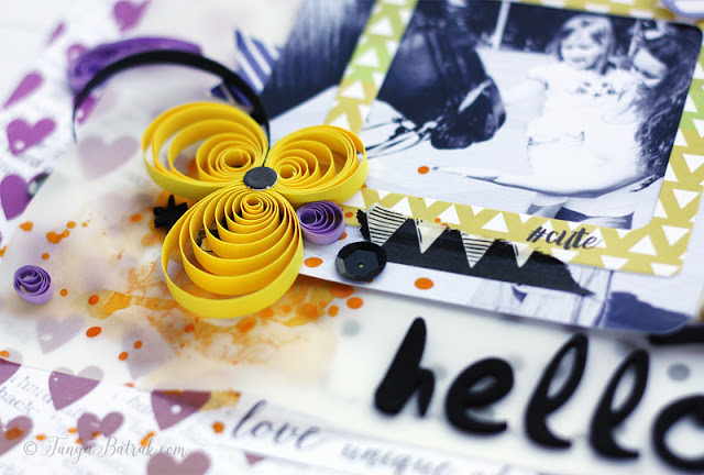 quilling on scrapbook layout
