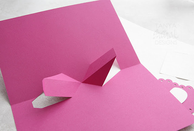 Pop up card with twisting element