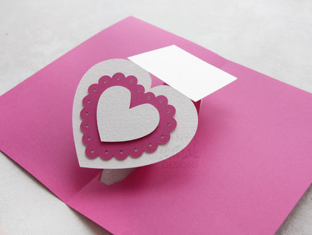 Pop up card with twisting heart